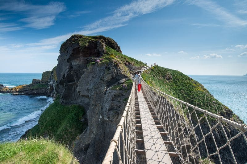 Walking across the Carrick a Rede rope bridge, one of the best things to do in Ireland.