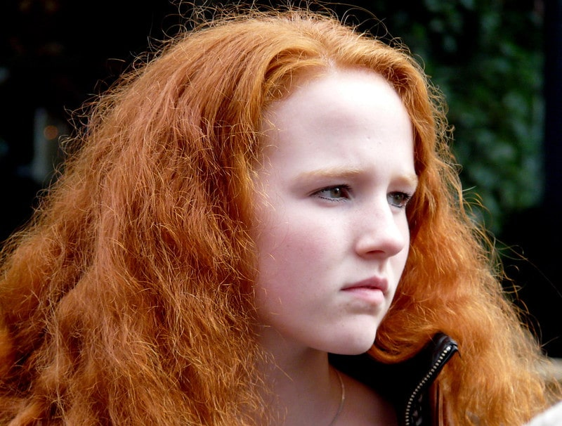 Redheads have less hair, but it's thicker – making the head look just as full.
