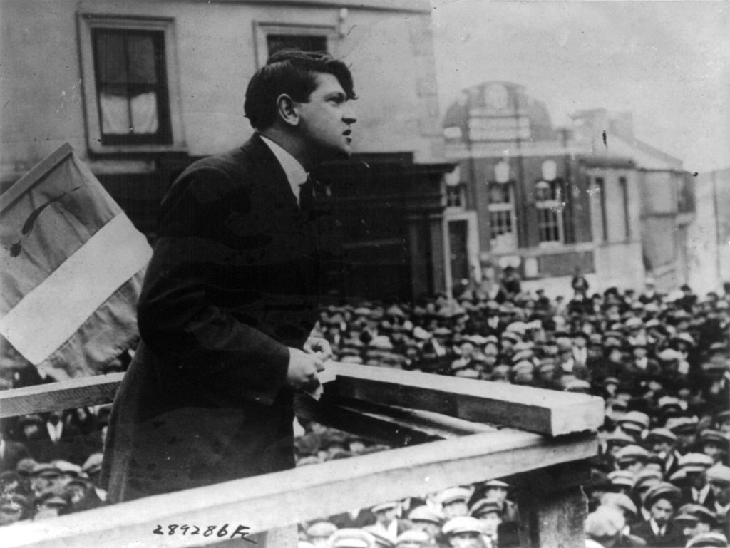 Michael Collins, speaking in public. He is one of Ireland's most significant figures.